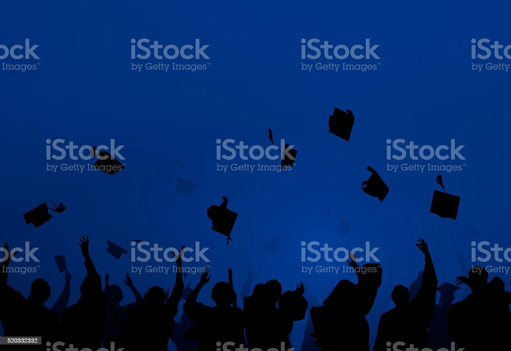 Group Of Diverse Students Celebrating Graduation stock photo