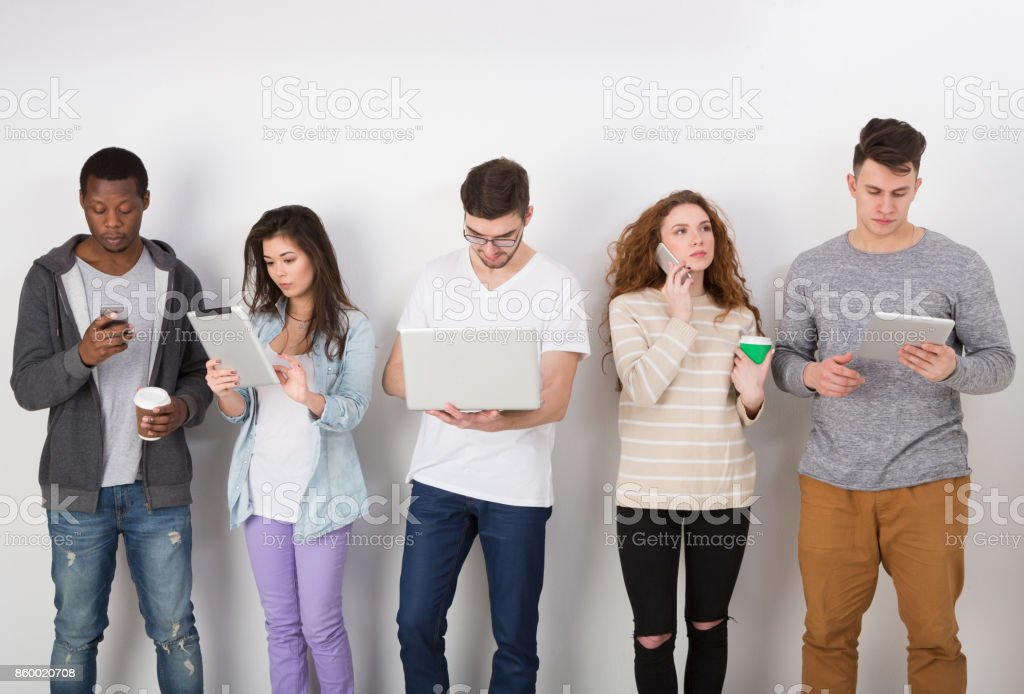 Group of diverse students standing in line indoors stock photo