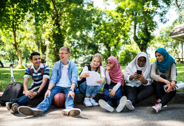 A group of diverse teenagers stock photo