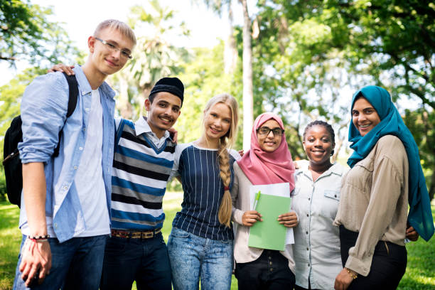 a group of diverse teenagers - arabic girl stock photos and pictures