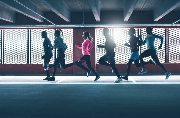 Group of diverse urban runners in a car park stock photo