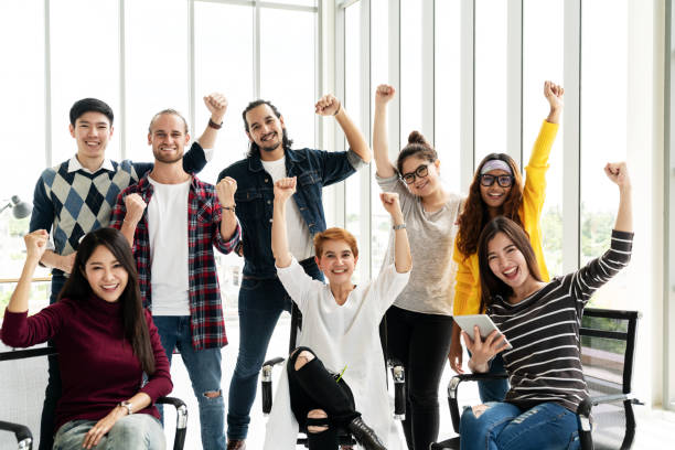 group of diversity people team smiling and cheerful in success work at modern office. creative multiethnic teamwork feeling happy, enjoy and engaged with achievement project with group shot concept. - employee engagement stock photos and pictures