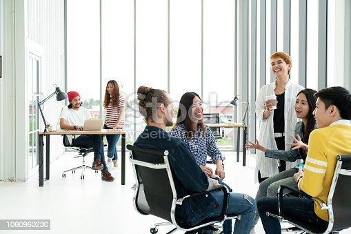 istock Group of Diversity People Team smiling, laughing and cheerful in small meeting at modern office. Creative Multiethnic teamwork talking together feeling happy, enjoy and engaged with project concept. 1060960230