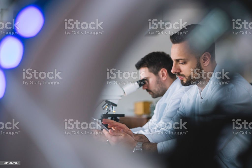 Group of doctors analyzing medical data on laptop in the laboratory