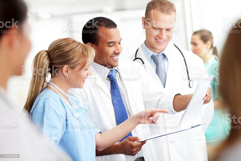 Group of doctors are looking at the patients results. royalty-free stock photo