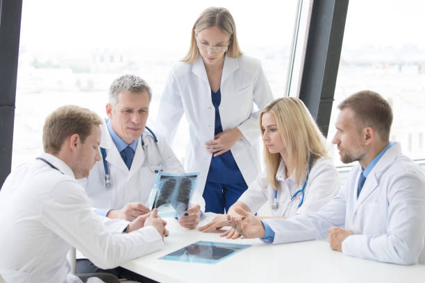 Group of doctors discuss x-ray stock photo