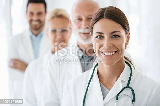 istock Group of doctors looking at the camera. 1074171558