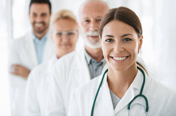 group of doctors looking at the camera. - assistant stock pictures, royalty-free photos & images