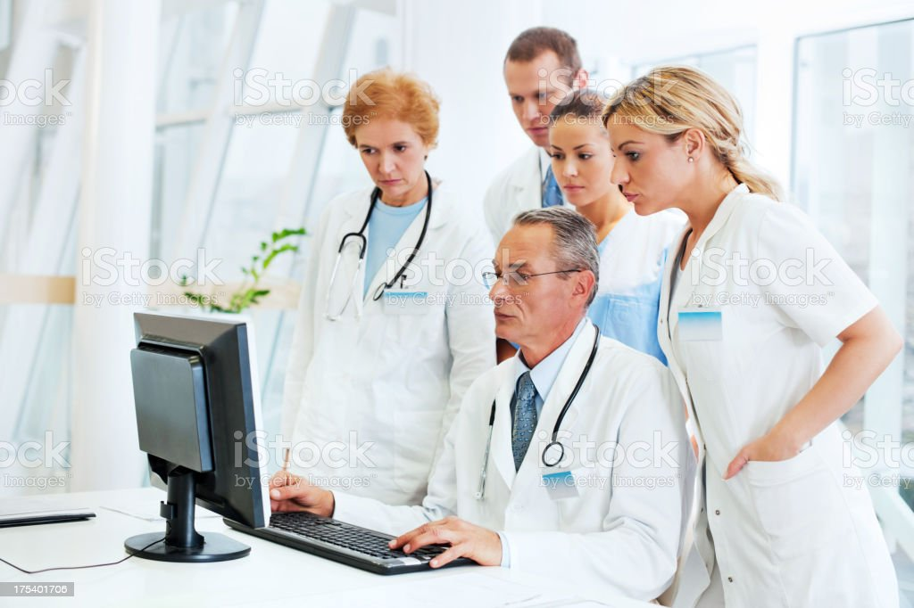 Group of  doctors looking on a computer. royalty-free stock photo
