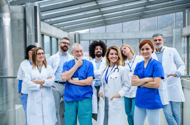 Group of doctors standing on conference, portrait of medical team. stock photo