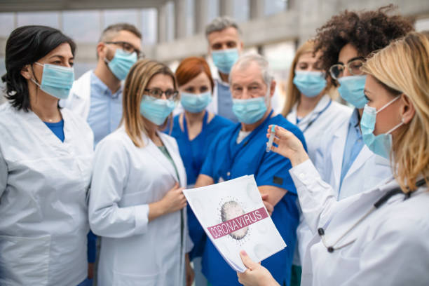 Group of doctors talking about corona virus on conference. stock photo