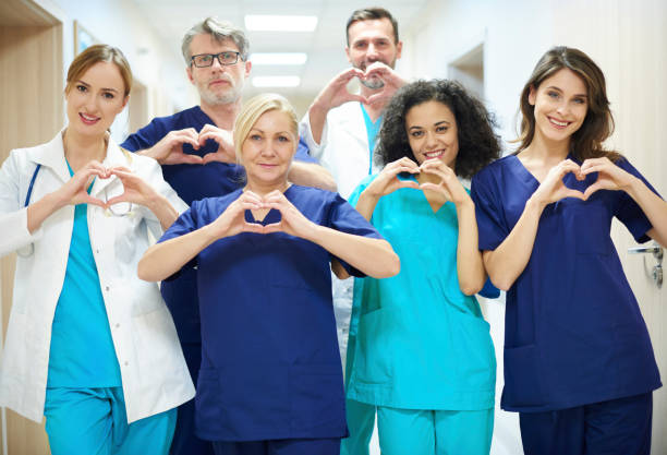 Group of doctors with heart symbol - foto stock