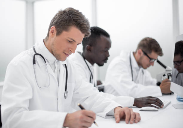 group of doctors working in the hospital laboratory stock photo