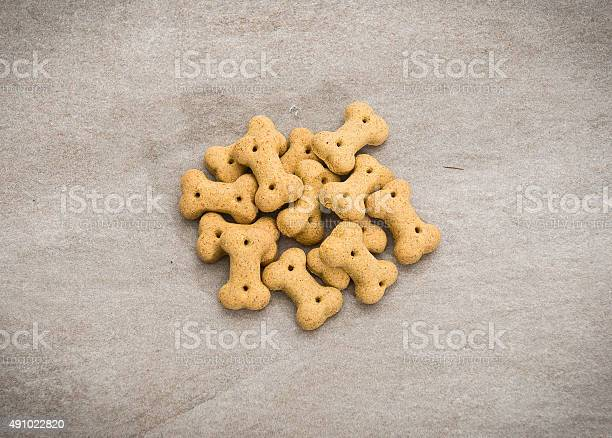 Group of dog biscuits isolated on modern table picture id491022820?b=1&k=6&m=491022820&s=612x612&h=b7gfvvhgrfou6eo 0l2qu jopuekah1q1pj2xol64wm=