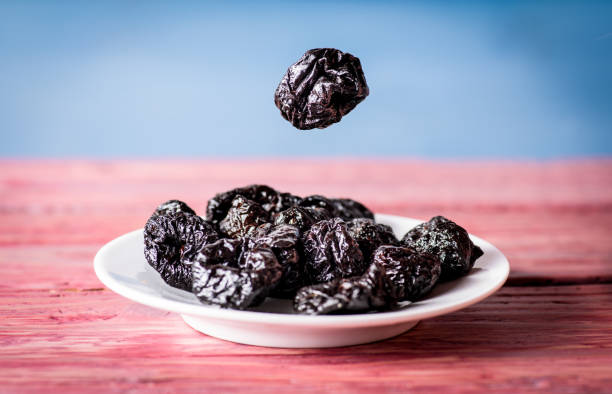 Group of dried plums stock photo