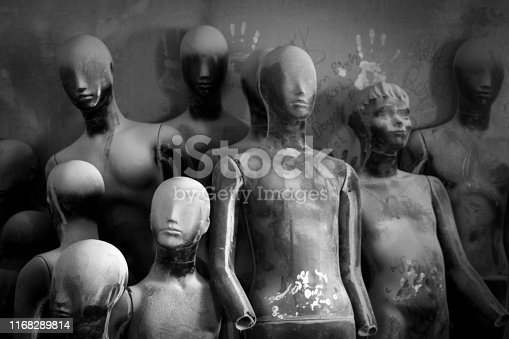 Group of dummies which are in front of the wall.
