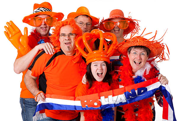 group of dutch soccer fans over white background - sports championship stock photos and pictures