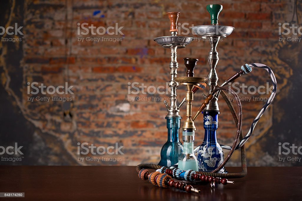 group of eastern hookahs on table stock photo