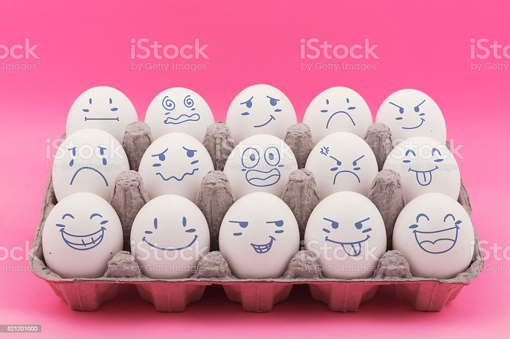 Group of eggs with expression faces representing stock photo