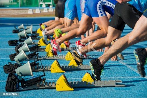 istock Group of eight athletes starting 100m sprint 165615061