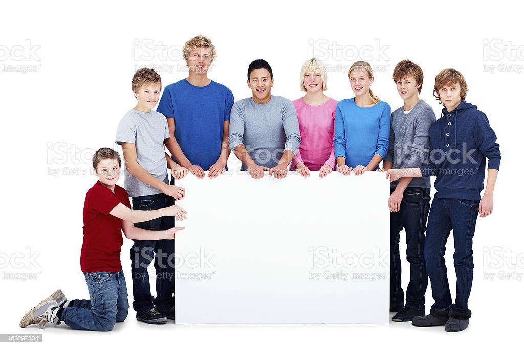Group of eight young kids holding an empty billboard royalty-free stock photo
