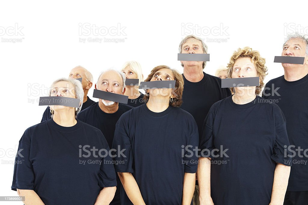Group of elderly people with their mouths covered stock photo