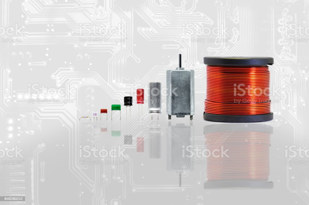 Group of electronics part with copper coil ferrite, capacitor, resistor, thermal fuse. stock photo