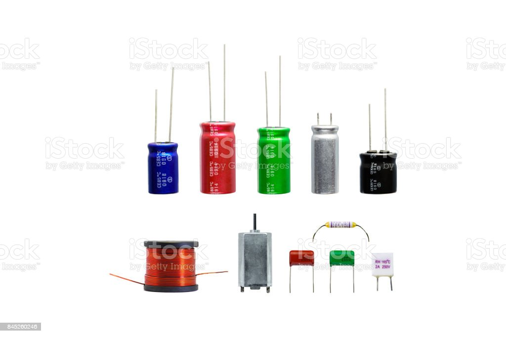 Group of electronics part with copper coil ferrite, capacitor, resistor, thermal fuse isolated. stock photo