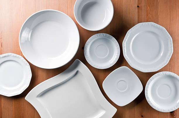 group of elegant china, everyday ceramics tableware on wooden table - skål porslin bildbanksfoton och bilder