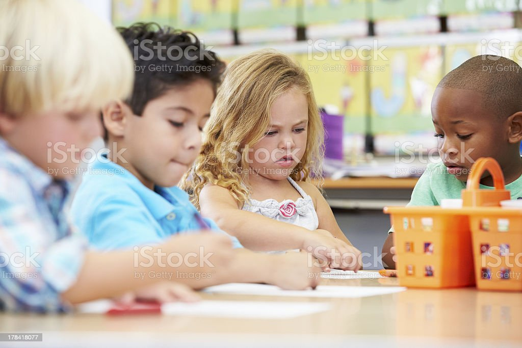 Group Of Elementary Age Children In Art Class stock photo