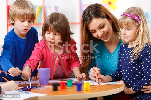 639271192 istock photo Group Of Elementary Age Children In Art Class With Teacher 485502929