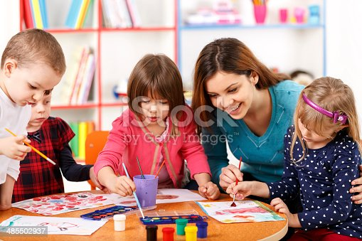 639271192 istock photo Group Of Elementary Age Children In Art Class With Teacher 485502937