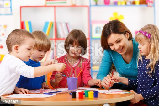 istock Group Of Elementary Age Children In Art Class With Teacher 494853971