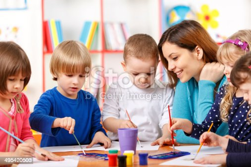 istock Group Of Elementary Age Children In Art Class With Teacher 495420503