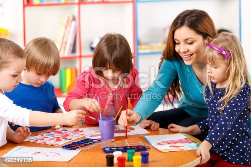 istock Group Of Elementary Age Children In Art Class With Teacher 496349105