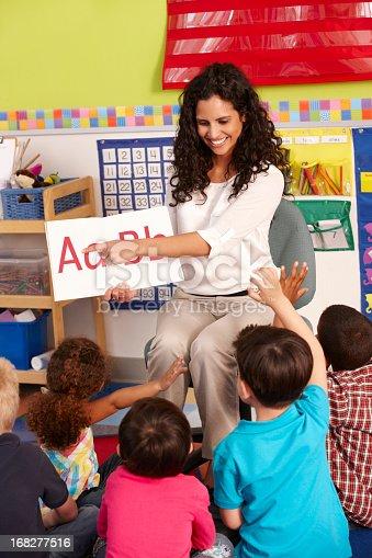 istock Group Of Elementary Age Schoolchildren In Class With Teacher 168277516