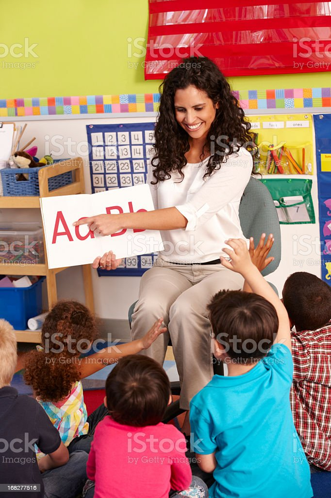 Group Of Elementary Age Schoolchildren In Class With Teacher stock photo