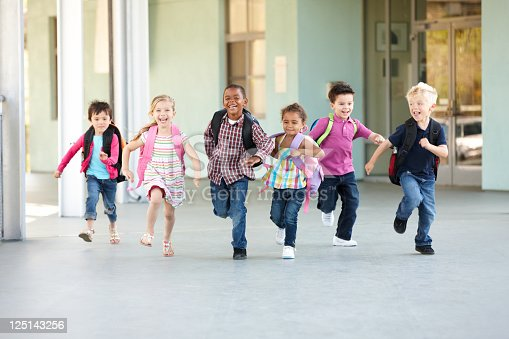 istock Group Of Elementary Age Schoolchildren Running Outside 125143256