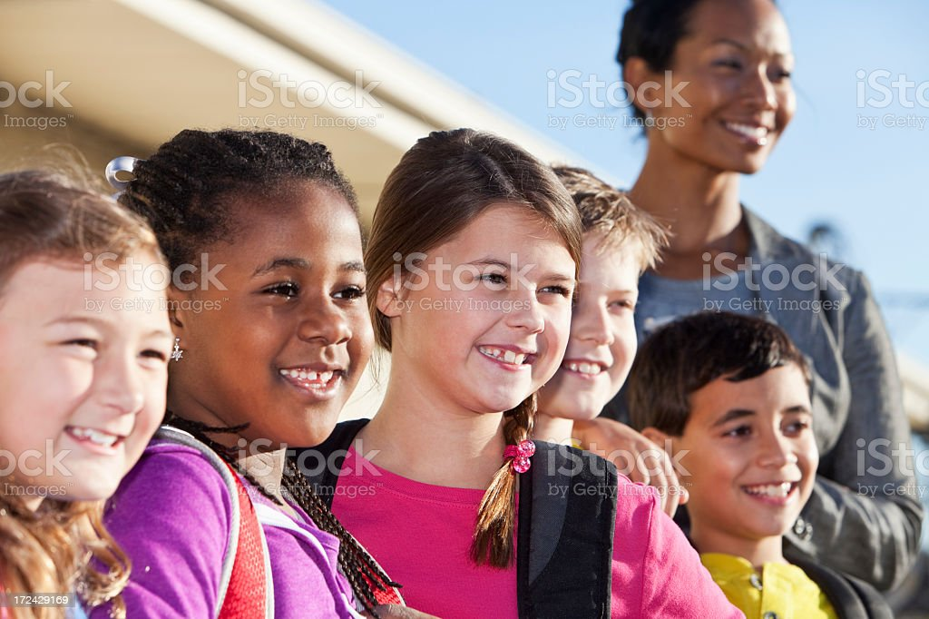 Group of elementary school children with teacher royalty-free stock photo
