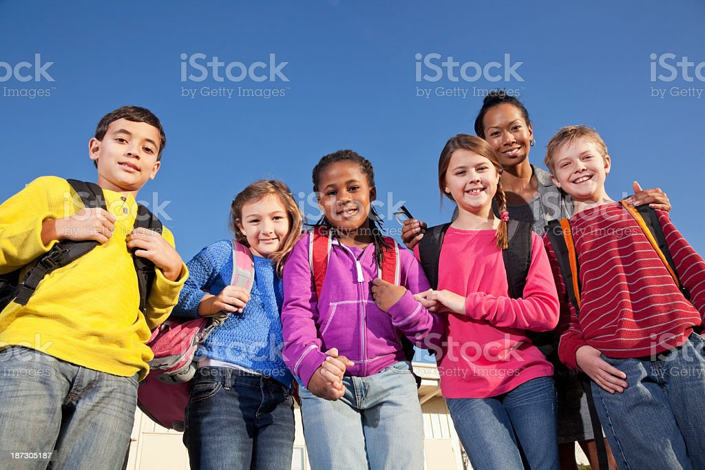 Group of elementary school children with teacher stock photo