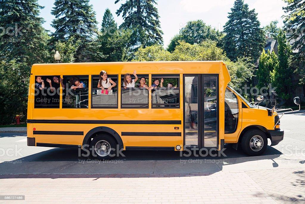 Group of elementary school kids in yellow school bus. ストックフォト