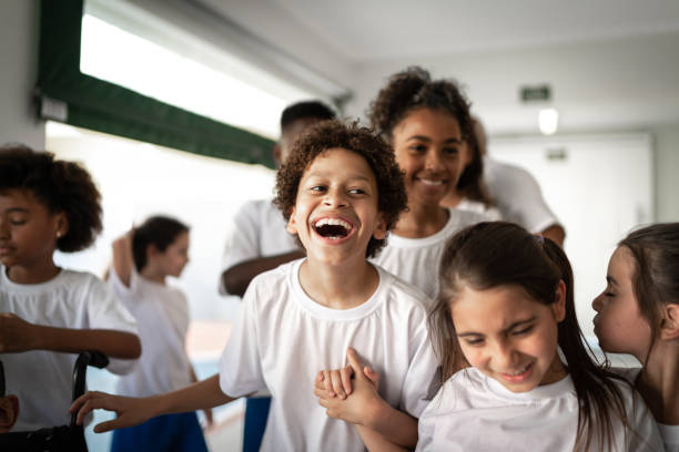 Group of elementary students having fun during break time stock photo