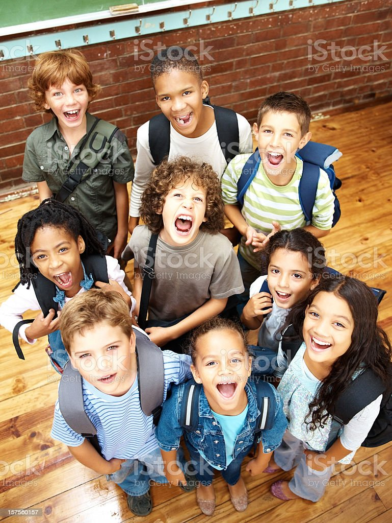 Group of elementary students looking upwards and screaming royalty-free stock photo