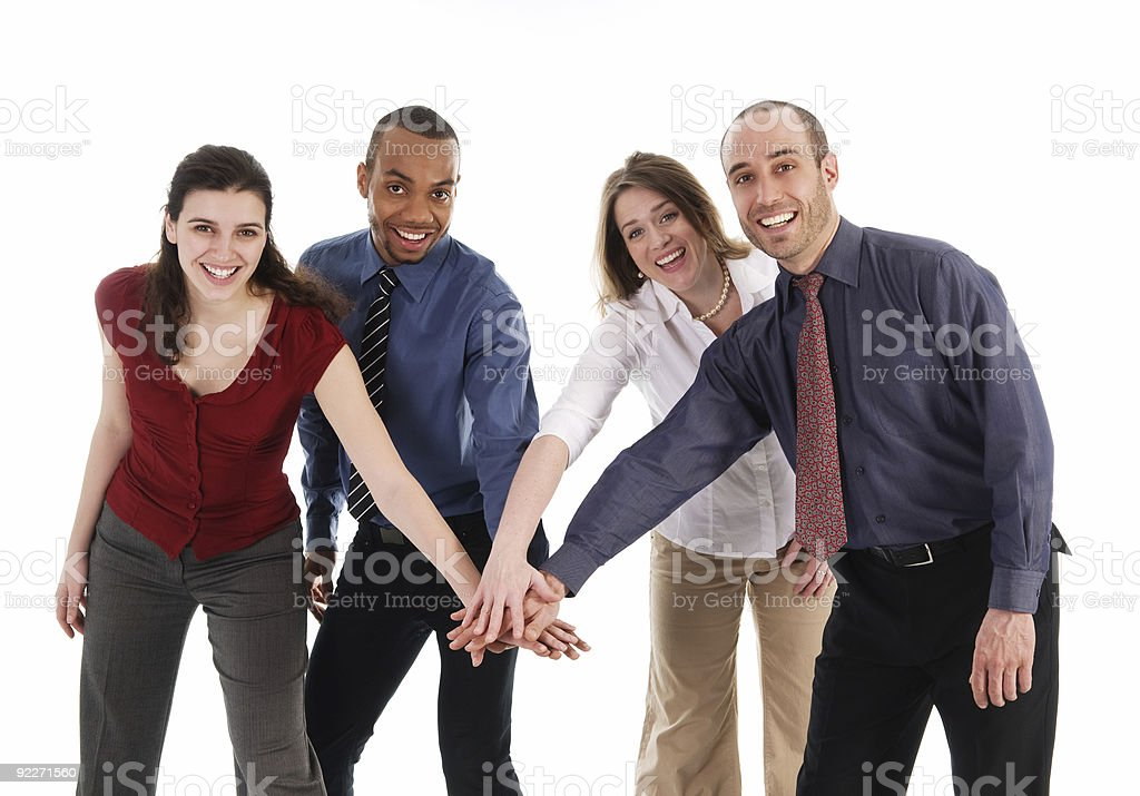 A group of employees putting their hands together royalty-free stock photo