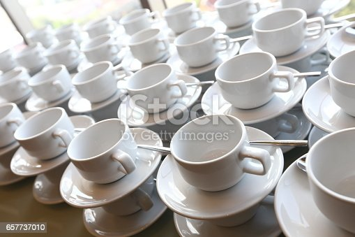 istock Group of empty coffee cups.Many rows of white cup for service tea or coffee in breakfast or buffet and seminar event. white cup in Catering and Cocktail. 657737010