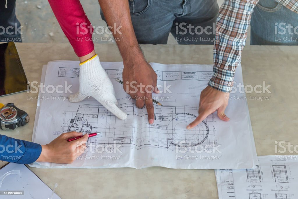 Group of engineer checking the blueprint on table and talking about group of engineer checking the blueprint on table and talking about construction project with commitment to malvernweather Gallery