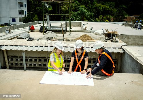 People working in a construction, using safety equipment