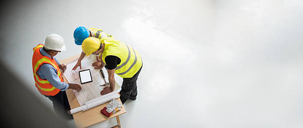 Group of engineers and architects supervising construction stock photo