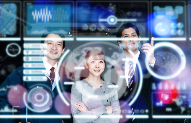 group of engineers looking at a futuristic graphical user interface. - business woman hologram imagens e fotografias de stock