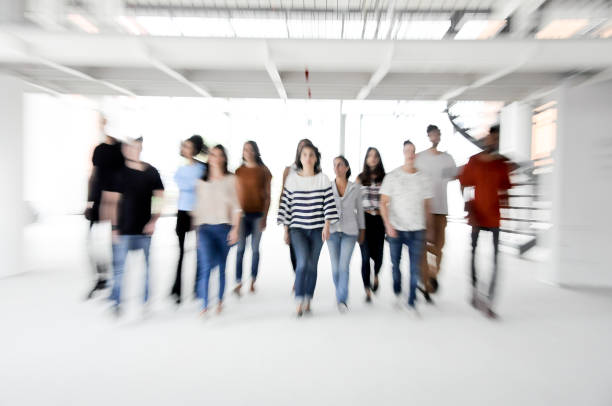 Group of enthusiastic business people walking stock photo